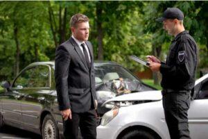 Officer making police report after car crash